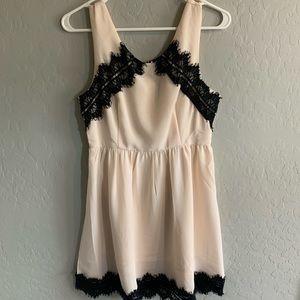 NSR cream and black lace dress
